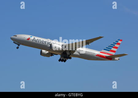 American Airlines Boeing 777-200ER N773AN departing from London Heathrow Airport, UK - Stock Photo