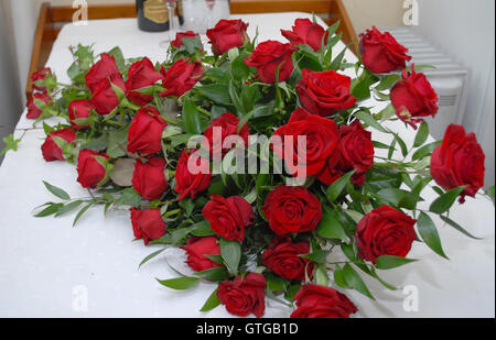 bouquet, red, flowers, bed, roses - Stock Photo
