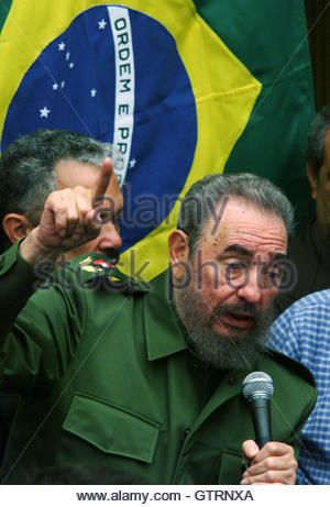 With a Brazilian flag hanging behind him, Cuban President Fidel Castro delivers a speech to the citizens of Niteroi - Stock Photo