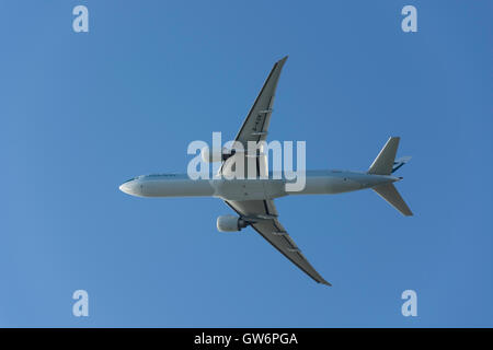 Cathay Pacific Boeing 777-367(ER) aircraft taking off from Heathrow Airport, Greater London, England, United Kingdom - Stock Photo
