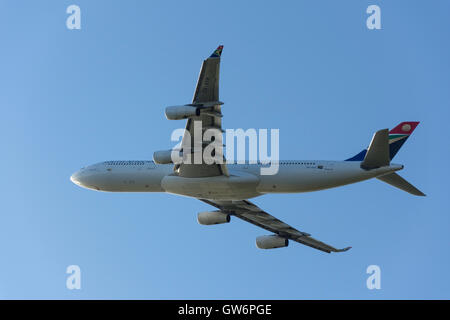 South African Airways Airbus A340-313 aircraft taking off from Heathrow Airport, Greater London, England, United - Stock Photo