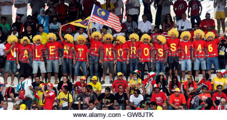 Fans of Ducati MotoGP rider Valentino Rossi of Italy show their support before the beginning of the Malaysian Grand - Stock Photo