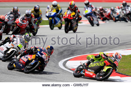 Aprilia 125cc rider Nicolas Terol of Spain leads a pack of riders during the first lap of the Malaysian Grand Prix - Stock Photo