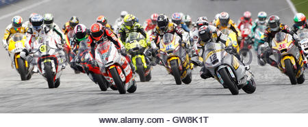 Moto2 riders take a corner during the first lap of the Malaysian Grand Prix in Sepang, outside Kuala Lumpur October - Stock Photo