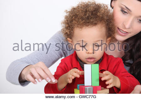 Mom playing with her adopted son. - Stock Photo
