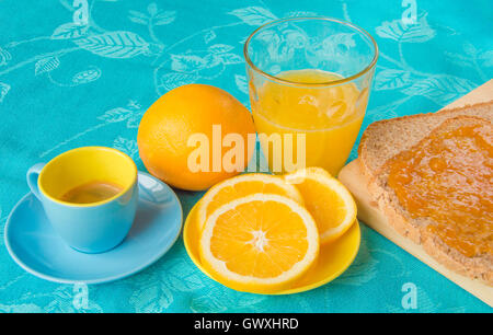 Good morning with orange juice, bread and jam - Stock Photo
