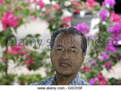Former Malaysia Prime Minister Mahathir Mohamad speaks to journalists at his residence in Kuala Lumpur October 23, - Stock Photo