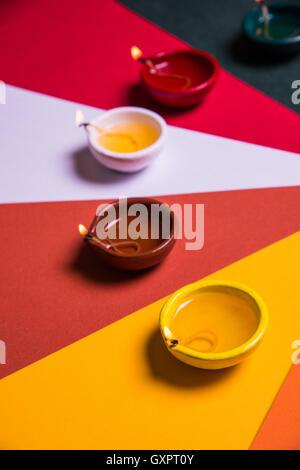 colourful diwali diya on colourful background - Stock Photo