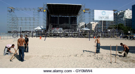 Workers set up the site for the Live Earth concert on Copacabana Beach in Rio de Janeiro July 4, 2007. Brazilian - Stock Photo