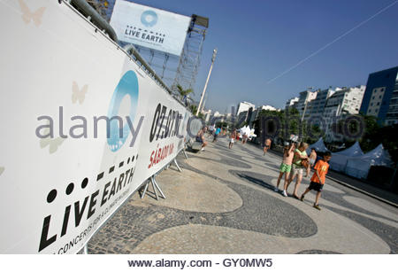 Residents walk past the site for the Live Earth concert on Copacabana Beach in Rio de Janeiro July 4, 2007. Brazilian - Stock Photo