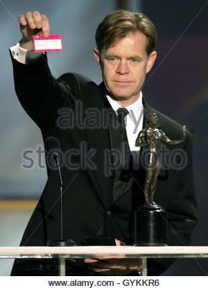 Actor William H. Macy holds up his Screen Actors Guild union card as he accepts his award for outstanding performance - Stock Photo