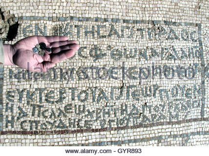 **REPEATED WITH CAPTION CLARIFICATION-A Jordanian shows coins discovered at an early Christian church named after - Stock Photo
