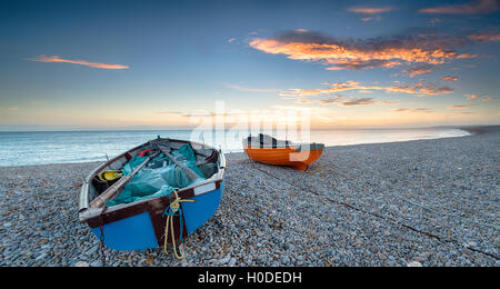 Boats at Chesil Cove on the Isle of Portland end of Chesil Beach near Weymouth in Dorset - Stock Photo