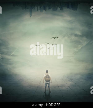 Surrealistic image with a man standing in a foggy street below a abstrat city - Stock Photo