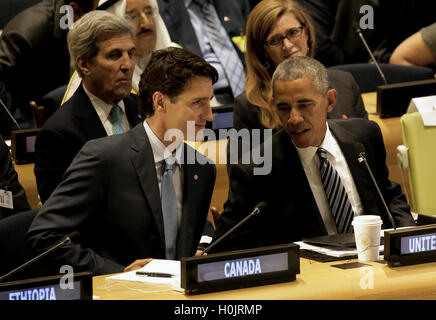 United States President Barack Obama (R) speaks with Canada's Prime Minister Justin Trudeau at a Leaders Summit - Stock Photo