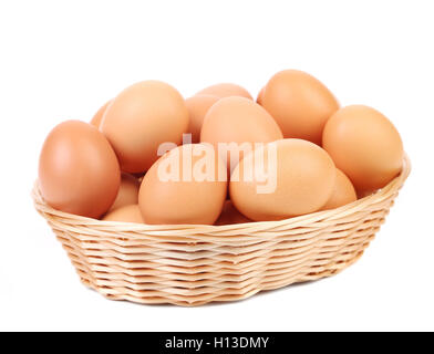 Brown eggs in the basket on a white. - Stock Photo