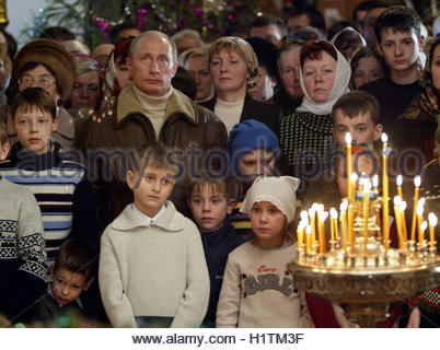 Russian President Vladimir Putin attends a Christmas service in the ancient Church of Nativity of the Virgin in - Stockfoto