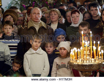 Russian President Putin attends Christmas service in ancient Church of Nativity of the Virgin in village of Gorodnya. - Stock Photo