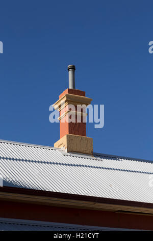 Detail of chimney on corrugated iron roof of the historic Cobar Railway Station Cobar New South Wales Australia - Stock Photo