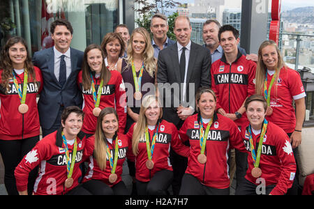 The Duke of Cambridge and Canadian Prime Minister Justin Trudeau meet some of Canada's Olympic athletes as they - Stock Photo