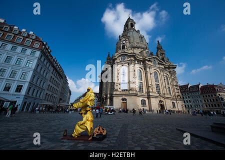 Dresden, Germany. 27th Sep, 2016. Two street artists dressed up as fakirs perform on Neumarkt in front of the Frauenkirche - Stock Photo
