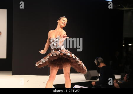 Paris, France. 28th Oct, 2016. A model dressed with chocolate poses in the Chocolate Fashion Show during the opening - Stock Photo