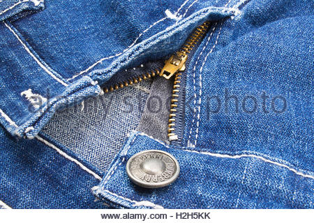 Brass zipper in denim pants - Stock Photo