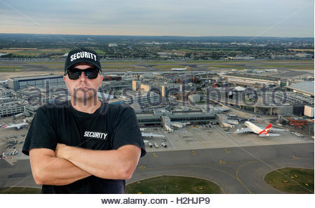London UK. Aerial view London Heathrow Airport Terminals 1,2 &3 with security guard before. - Stock Photo