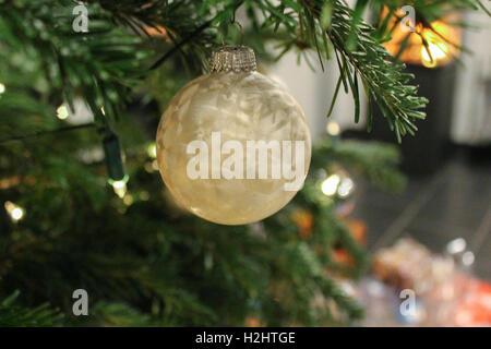 Christmas ball are hanging on Christmas pine tree. - Stock Photo