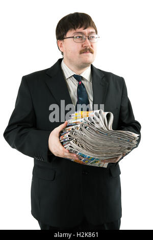 man holding a stack of newspapers - Stock Photo