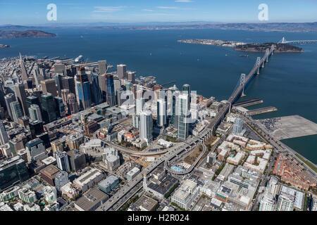 Afternoon aerial view of San Francisco city, bay and bridge towards Oakland, California. - Stock Photo
