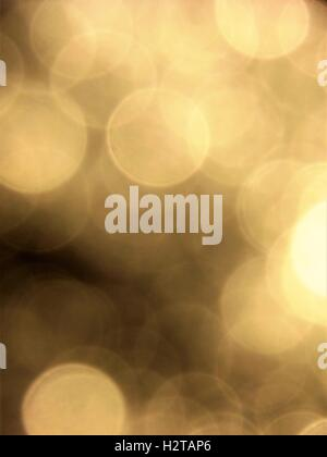 Gold bokeh background on black. - Stock Photo