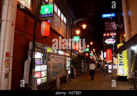 Japanese people and traveler foreigner walking in small alley in Dotonbori area for travel visit and shopping at - Stock Photo