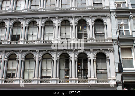 Vintage apartment building in New York City with arched windows - Stock Photo