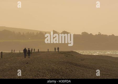 couple walking on the coast - Stock Photo