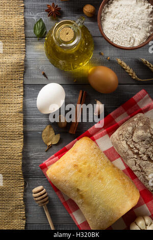 bread and bakery products on wood background - Stock Photo