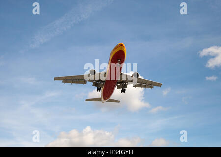 DHL Aircraft approaching London Heathrow airport. - Stock Photo