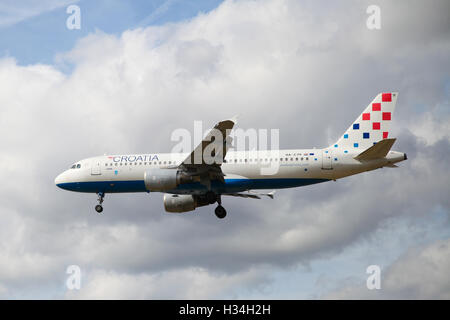 Croatia Airlines - Airbus A320-214 approaching London Heathrow airport. - Stock Photo