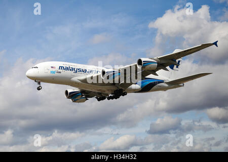 Malaysia Airlines Airbus A380-841 approaching London Heathrow airport. - Stock Photo
