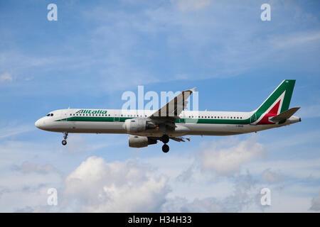 Alitalia Airbus A321-112 approaching London Heathrow airport. - Stock Photo