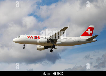 Swiss Airbus A320-214 approaching London Heathrow airport. - Stock Photo