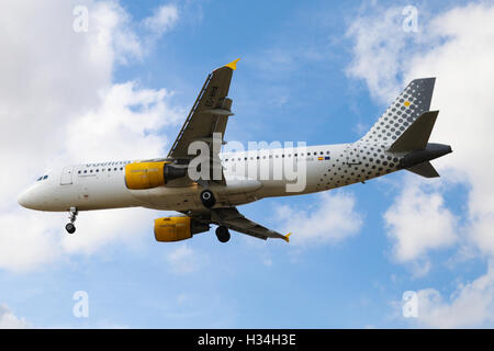 Vueling Airbus A320-214 approaching London Heathrow airport. - Stock Photo