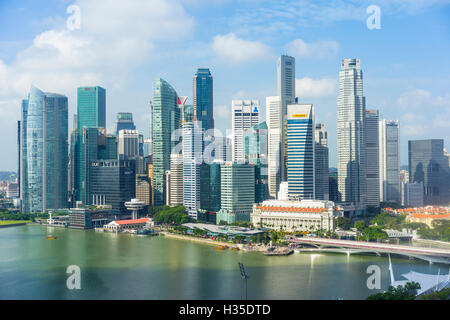 Singapore skyline, skyscrapers with the Fullerton Hotel and Jubilee Bridge in the foreground by Marina Bay, Singapore - Stock Photo