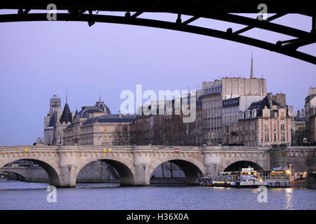 The twilight view of River Seine from Pont des Arts (Arts Bridge) with Pont Neuf (New Bridge) in the background.Paris.France - Stock Photo