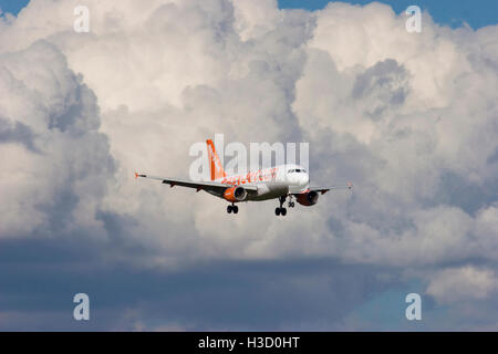 G-EZEW EasyJet Airbus A319-111 on final approach to London Stansted with heavy storm clouds in the background. 29th - Stock Photo