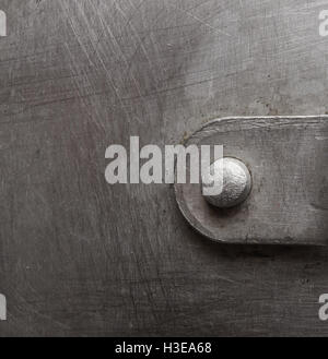 texture of the old aluminum surface with rivets, corrosion, scratches, and dents - Stock Photo
