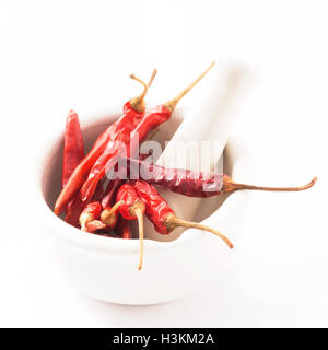 Red Chili in white mortar Red Chili isolated on white background - Stock Photo