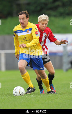 Chris Moore of Wealdstone shields the ball from Alex Bentley of Hornchurch - AFC Hornchurch vs Wealdstone - FA Challenge - Stock Photo