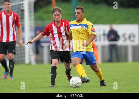 Kurtney Brooks of Wealdstone shields the ball from Joey May of Hornchurch - AFC Hornchurch vs Wealdstone - FA Challenge - Stock Photo