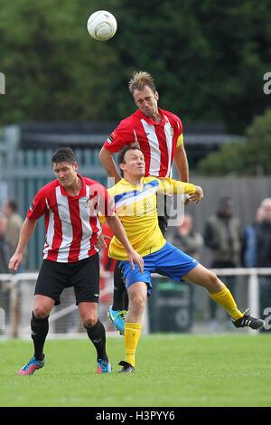 Elliot Styles of Hornchurch rises above Chris Moore of Wealdstone - AFC Hornchurch vs Wealdstone - FA Challenge - Stock Photo